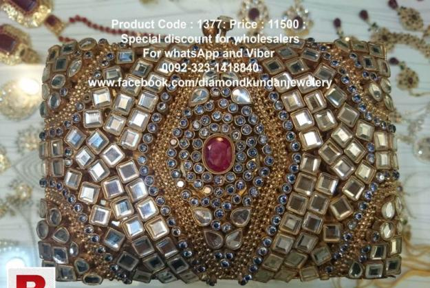 24 carat gold plated beautiful kundan clutch with real