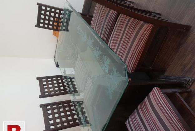 Dining table glass top with 6 chairs. solid wood. in good