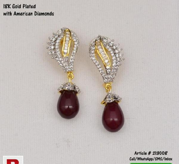 Gold plated ear rings with american diamonds and brown