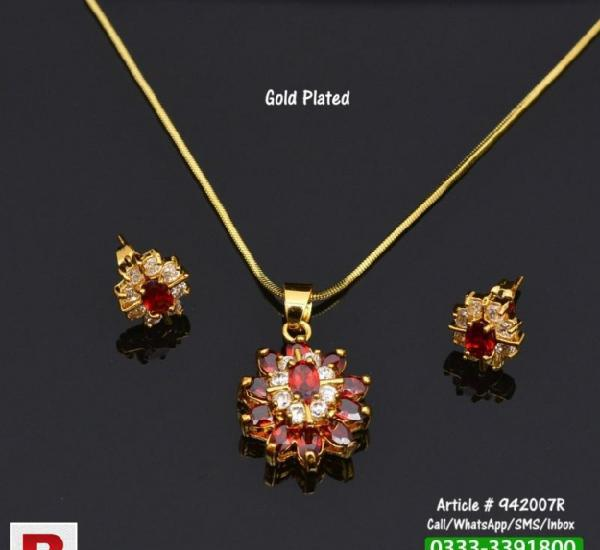 Gold plated necklace + earrings set with red and white