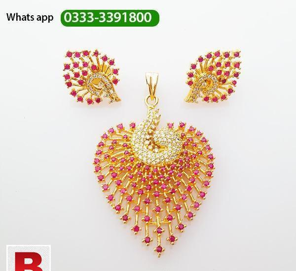 Gold plated necklace earrings set with rubies and american