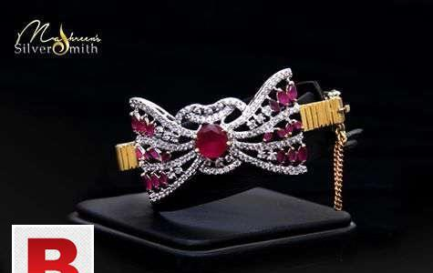 Silver bracelet 21k gold plated studded with red ruby and