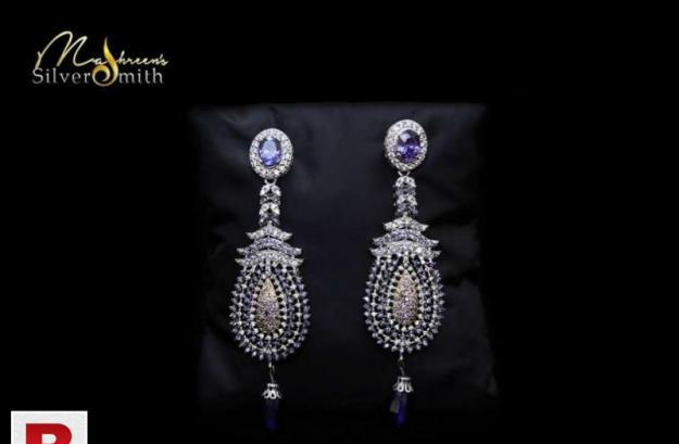 Silver ear ring studded with real ziconia and neelam