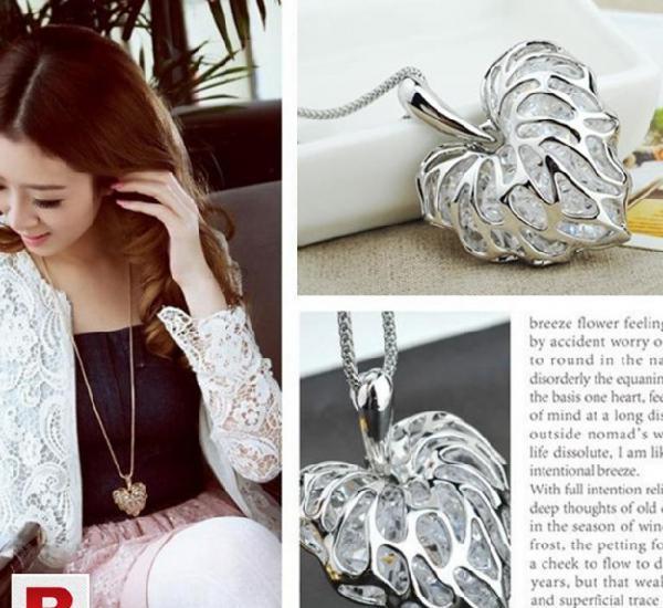 Silver plated pierced heart built zircon pendant long