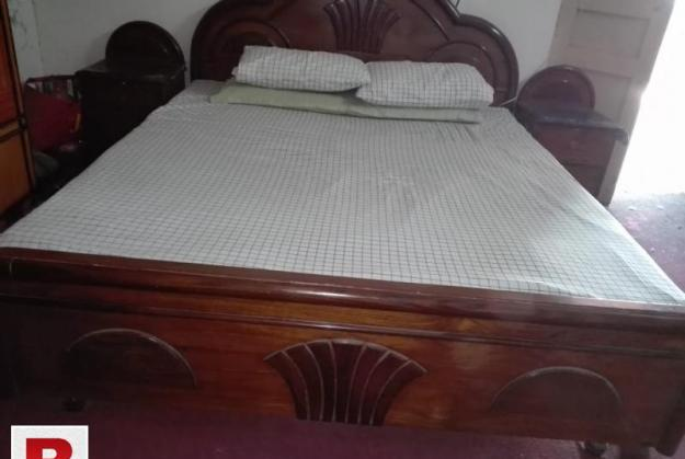 Wooden double bed with two side tables and dressing table