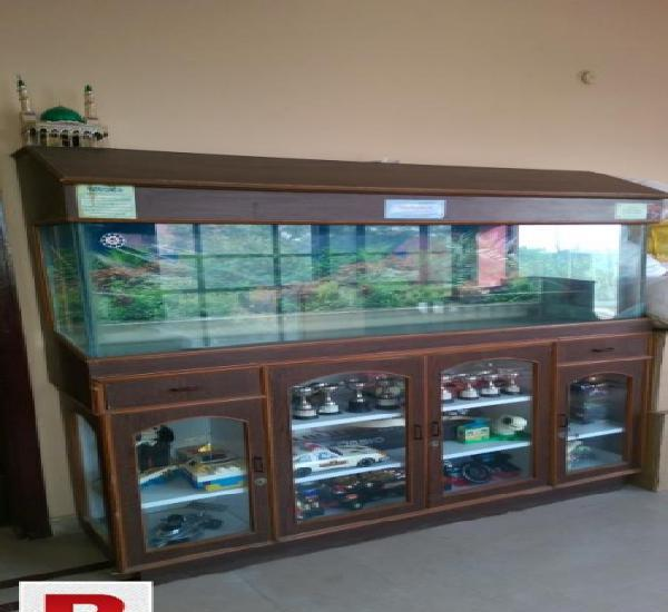 Aquarium glass and wooden stand
