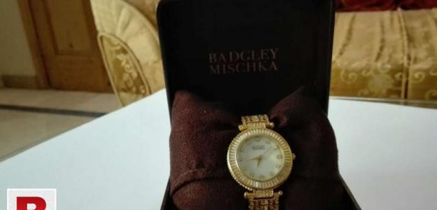 Crystal covered gold bracelet watch