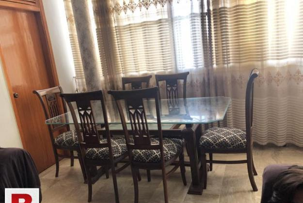 Six seater dining table glass top slidly used bought from