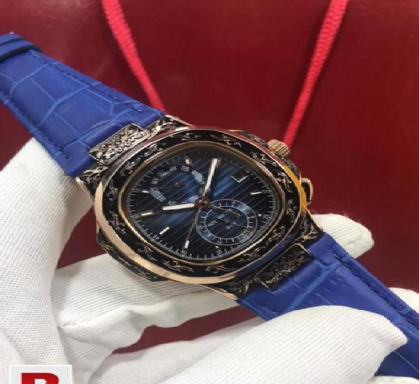 Patek philippe nautilus hand engraved watch