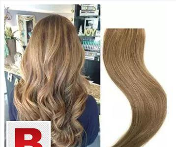 Clip in curly hair extensions golden brown 27 inches
