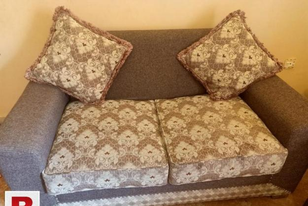 7 seater sofa with cushions.